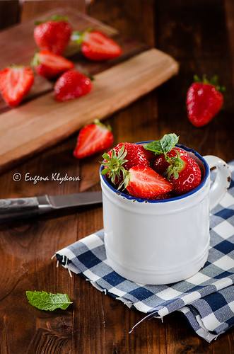Fresh ripe red strawberries in white cup
