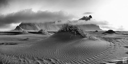 austurland island is bw sand beach coast southeast blacksand graphite lowangle grasshills texture vestrahorn stokksnes mountain seascape windy nature landscape sunlight beam panorama serene sun sea light morning sunrise foggy time