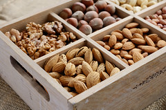 Nut mix in wooden box - walnut, almond, hazelnut,…
