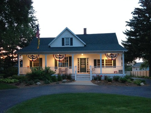 patriotic farmhouse at dusk