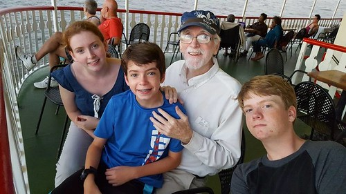 Longtime WWOZ volunteer Dan Fitzgerald with his children, Ivy and Henry, and nephew Max