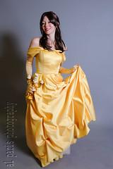 bridal clothing(0.0), abdomen(0.0), wedding dress(0.0), bridesmaid(0.0), prom(0.0), textile(1.0), model(1.0), gown(1.0), clothing(1.0), yellow(1.0), cocktail dress(1.0), woman(1.0), fashion(1.0), female(1.0), satin(1.0), formal wear(1.0), fashion design(1.0), photo shoot(1.0), dress(1.0),