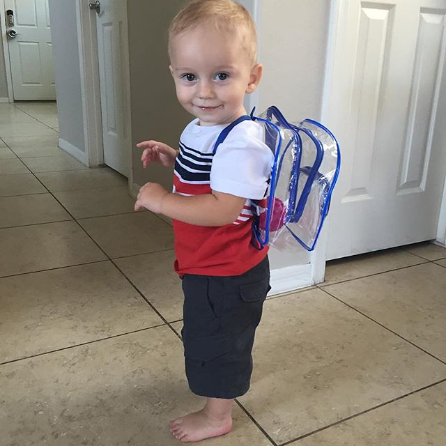 Showing off his back pack. by bartlewife