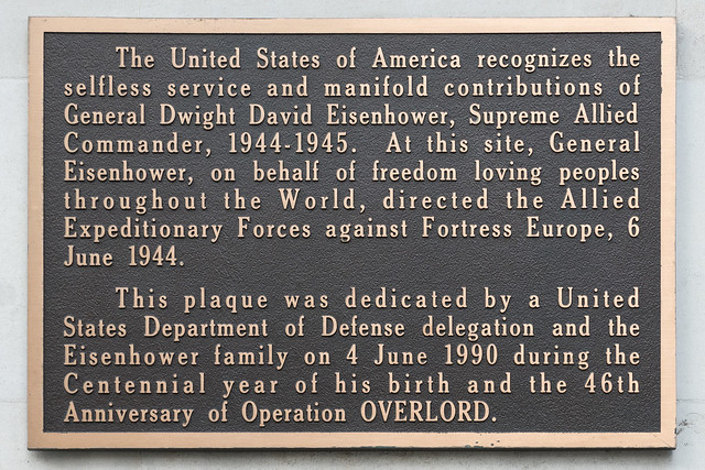 Dwight D. Eisenhower and Operation Overlord brown plaque - The United States of America recognises the selfless service and manifold contributions of General Dwight David Eisenhower, Supreme Allied Commander, 1944-1945. At this site General Eisenhower, on behalf of freedom loving peoples throughout the world, directed the Allied Expeditionary Forces against Fortress Europe, 6 June 1944. This plaque was dedicated by a United States Department of Defense delegation and the Eisenhower family on 4 June 1990 during the Centennial year of his birth and the 46