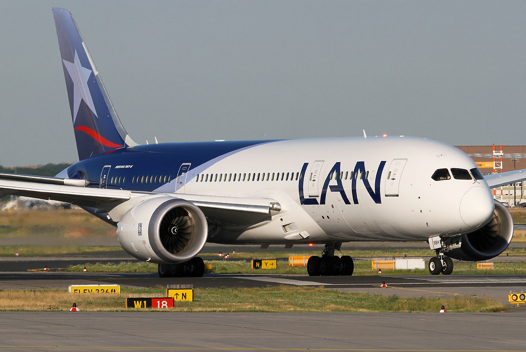 LA705 to Santiago de Chile via Madrid is lining up on RWY18 for departure in lovely evening light. Delivered 09/2014.