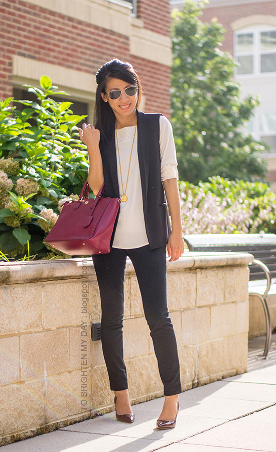 black vest, cream faux leather yoke top, black pants, raspberry purple tote, dark red pumps