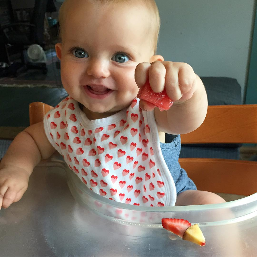 First taste of watermelon! / first snack in her new high chair. #hattiegram #mainesummer