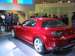 family car(0.0), alfa romeo brera(0.0), automobile(1.0), automotive exterior(1.0), executive car(1.0), vehicle(1.0), automotive design(1.0), auto show(1.0), land vehicle(1.0), luxury vehicle(1.0), mazda rx-8(1.0), supercar(1.0), sports car(1.0),