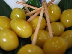 vegetable(0.0), citrus(0.0), plant(0.0), yellow(1.0), olive(1.0), produce(1.0), fruit(1.0), food(1.0),