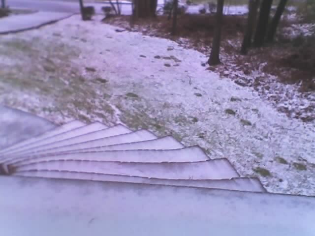 The front porch with snow on it