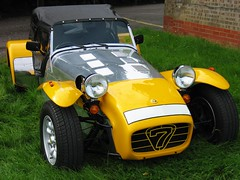 sports car(0.0), race car(1.0), automobile(1.0), lotus(1.0), lotus seven(1.0), yellow(1.0), vehicle(1.0), automotive design(1.0), caterham 7 csr(1.0), caterham 7(1.0), antique car(1.0), vintage car(1.0), land vehicle(1.0),