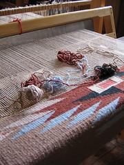 flooring(0.0), art(1.0), weaving(1.0), textile(1.0), red(1.0),