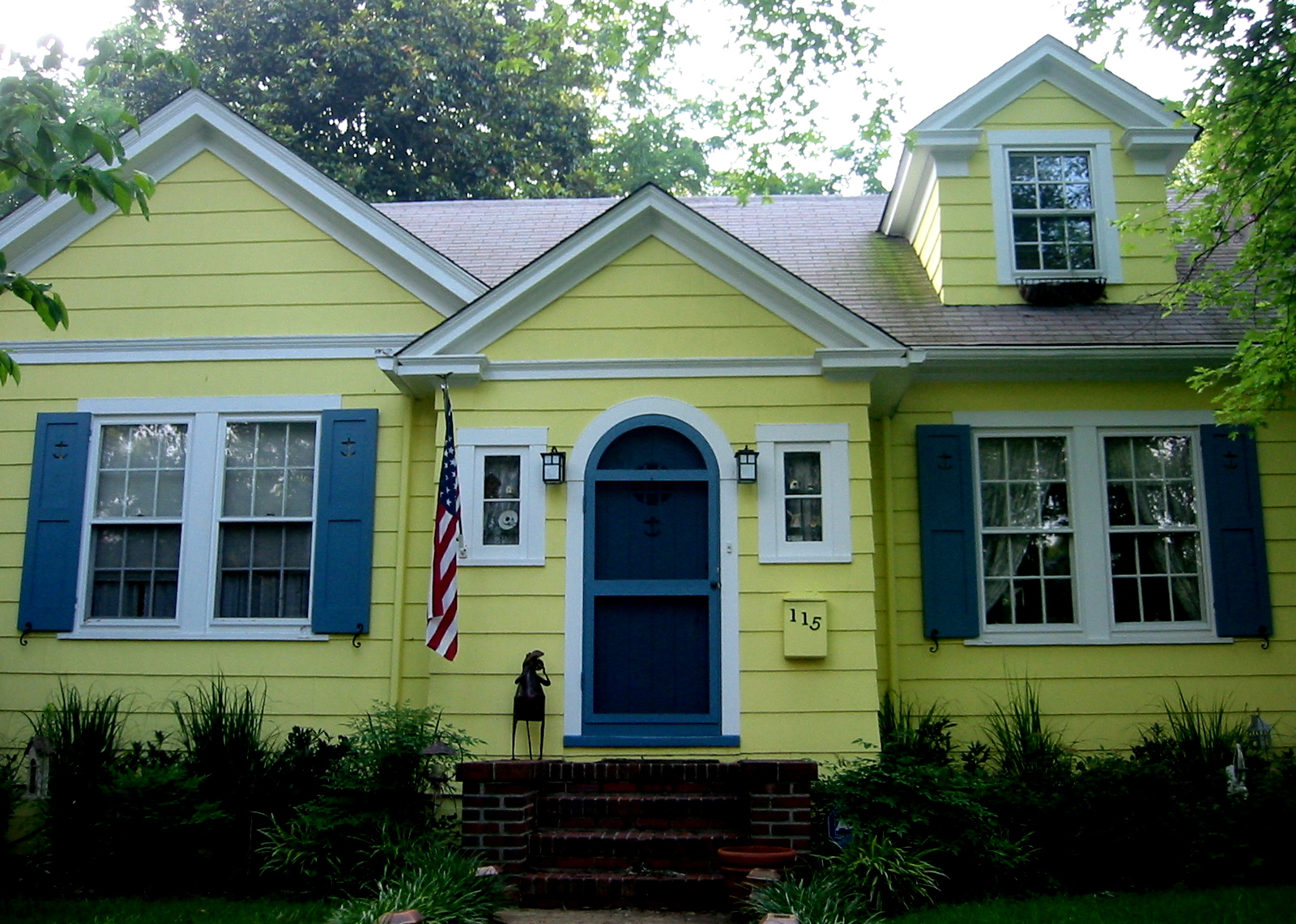 Yellow house blue shutters modern world furnishing designer for Modern house yellow