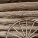 Old log house and wagon wheel by stephen w morris