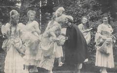 Two women in costume prepare to kiss