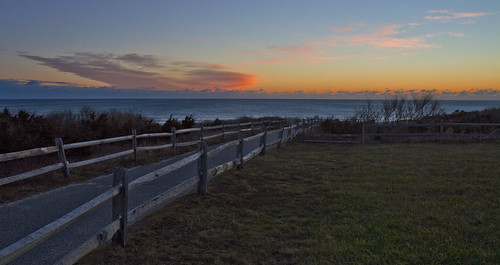beach path road fence sunlight dawn predawn glow morning sunrise awake view travel scenery landscape water ocean sea blue coast coastline winter field nature
