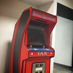 recreation(0.0), arcade game(1.0), red(1.0), video game arcade cabinet(1.0), games(1.0), gadget(1.0),