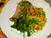 Roast chicken leg with Spanish rice and padron peppers