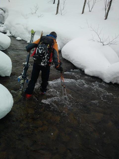 Photo by Nate Breznau - Wading across a stream near Mt. Kimobetsu (Hokkaido, Japan)