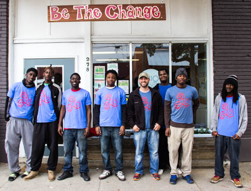 "Men standing near ""Be the Change"" sign in Clarksdale, Mississippi"