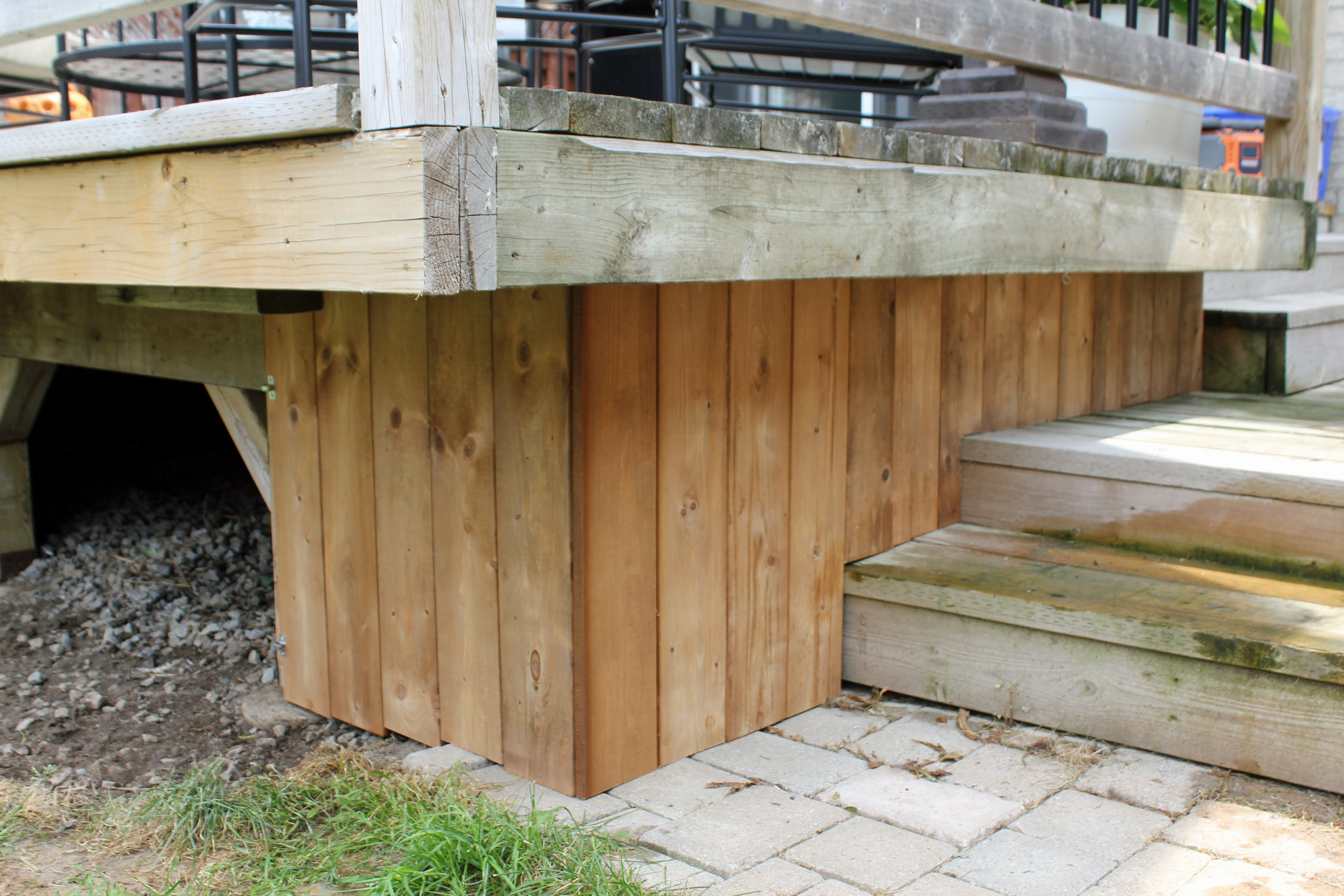 Turtles and tails under deck enclosure with access door for Balcony underside
