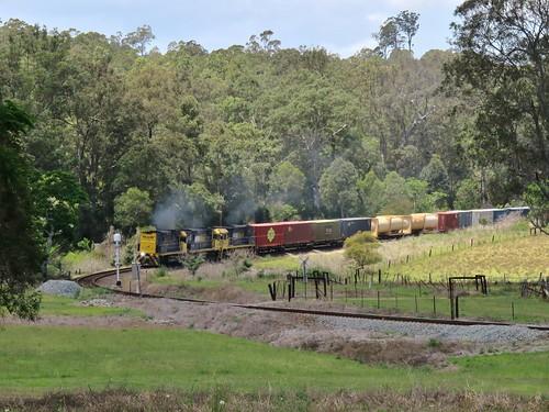 Running long end leading due to an earlier loco failure, NR27+NR69+NR44 bring train 6BA6 through Mount George, NSW. (2)
