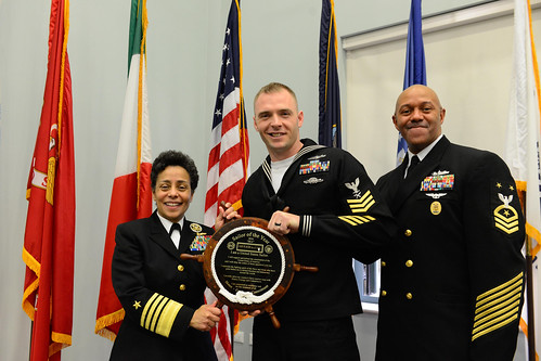 Fri, 01/27/2017 - 10:48 - 170127-N-SS492-648 NAVAL SUPPORT ACTIVITY NAPLES, Italy (Jan. 27, 2017) From left to right: Commander, U.S. Naval Forces Europe-Africa, Adm. Michelle Howard; U.S. Naval Forces Europe-Africa Sea Sailor of the Year, Intelligence Specialist 1st Class Kevin Pulley; and U.S. Naval Forces Europe-Africa Fleet Master Chief Raymond D. Kemp Sr. pose for a photo as Howard presents Pulley with a plaque at the Commander, U.S. Naval Forces Europe-Africa Sailor of the Year ceremony Jan. 27, 2017.  U.S. Naval Forces Europe-Africa, headquartered in Naples, Italy, oversees joint and naval operations, often in concert with allied, joint, and interagency partners, to enable enduring relationships, and increase vigilance and resilience in Europe and Africa. (U.S. Navy photo by Chief Mass Communication Specialist Brian P. Biller/Released)