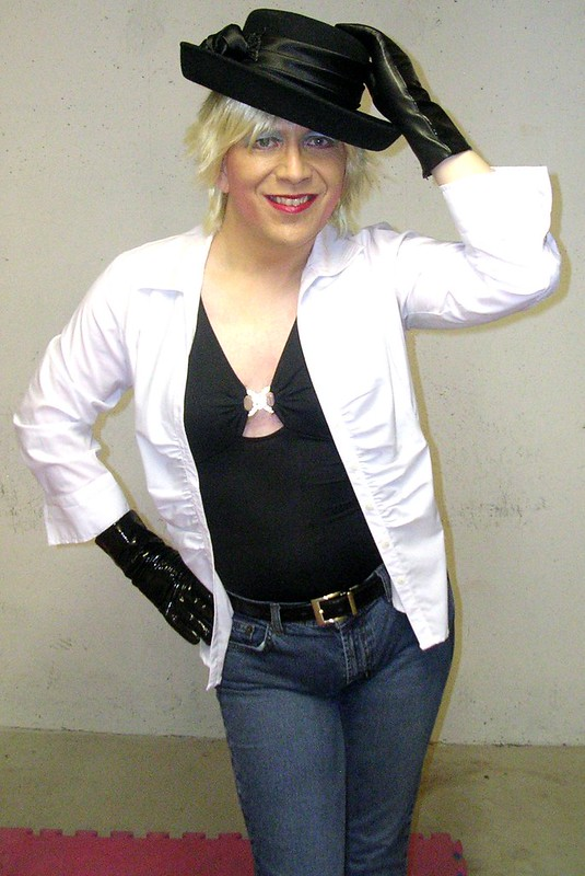 White shirt w/ black hat & jeans