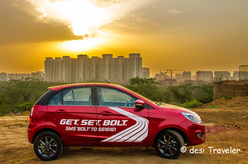 Red Tata Bolt Car against sunset in Gurgaon