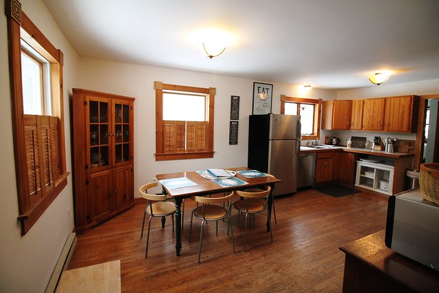 Country style eat in kitchen with original hardwood floors and updated kitchen;