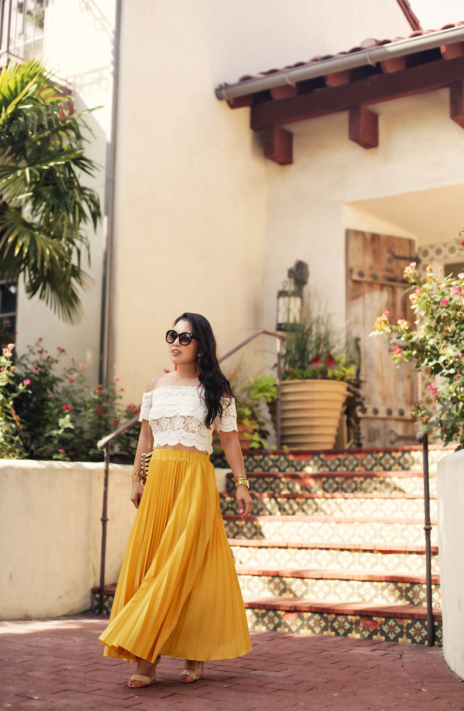 cute & little blog | petite fashion | lace crop top, mustard pleated maxi skirt, kate spade toucan clutch, baublebar tassel earrings | spring summer outfit