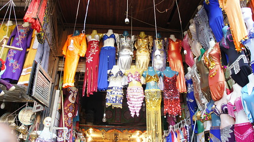 Traditional, short and sequin belly dance suits in a shop at the entrance of the Khan