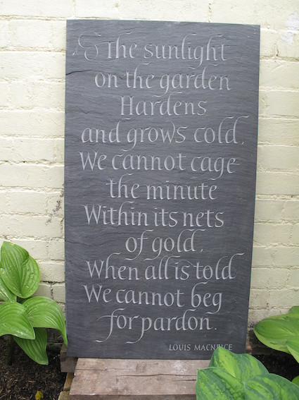 Freely carved quotation, riven Welsh slate.
