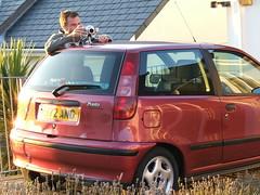 automobile(1.0), automotive exterior(1.0), fiat(1.0), family car(1.0), vehicle(1.0), fiat punto(1.0), city car(1.0), compact car(1.0), bumper(1.0), land vehicle(1.0), hatchback(1.0),