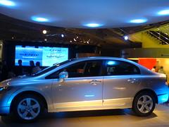 automobile(1.0), automotive exterior(1.0), family car(1.0), vehicle(1.0), auto show(1.0), honda(1.0), compact car(1.0), honda civic hybrid(1.0), sedan(1.0), land vehicle(1.0), honda civic(1.0),