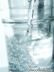 glass bottle(0.0), bottle(0.0), bottled water(0.0), alcoholic beverage(0.0), water(1.0), drinkware(1.0), distilled beverage(1.0), highball glass(1.0), glass(1.0), drink(1.0), mineral water(1.0), drinking water(1.0),