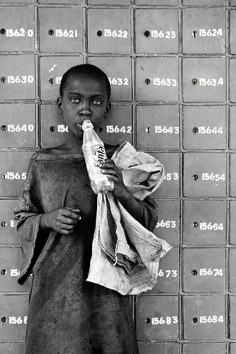 boy sniffing glue at post office, nakuru, kenya
