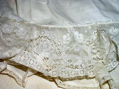 gown(0.0), doily(0.0), tablecloth(0.0), lace(1.0), art(1.0), pattern(1.0), textile(1.0), clothing(1.0), crochet(1.0),