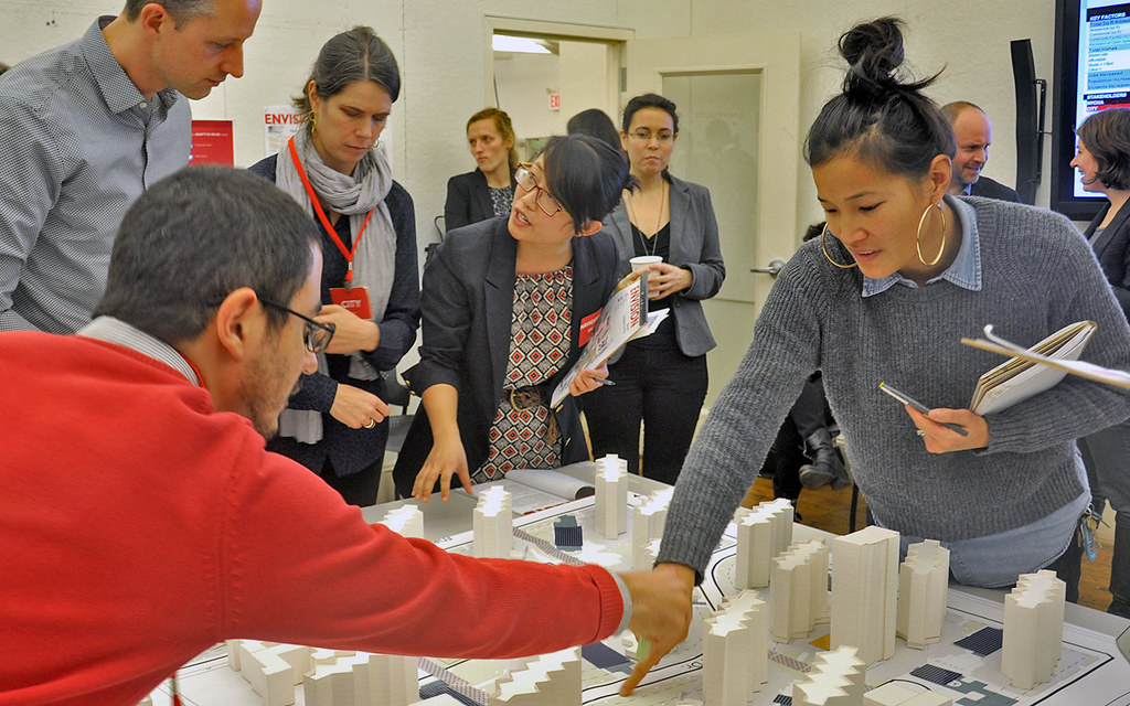 Guest jurors collaborate on development decisions for the Envision Baruch planning model.