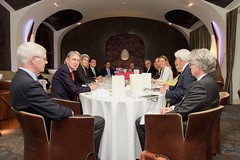 U.S. Secretary of State John Kerry sits across from European Union High Representative for Foreign Affairs Federica Mogherini and representatives of the P5+1 nations on June 28, 2015, in Vienna, Austria, before a working lunch amid their negotiations with Iranian leaders about the future of their nuclear program. [State Department Photo/Public Domain]