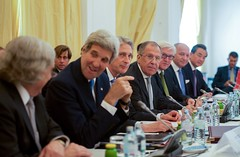 U.S. Secretary of State John Kerry chats with U.S. Energy Secretary Dr. Ernest Moniz as he sits next to British Foreign Secretary Philip Hammond, Russian Foreign Minister Sergey Lavrov, German Foreign Minister Frank-Walter Steinmeier, French Foreign Minister Laurent Fabius, and Chinese Foreign Minister Wang Yi on July 6, 2015, in Vienna, Austria, before the P5+1 member countries met with Iranian officials amid negotiations about the future of their country's nuclear program. [State Department Photo/ Public Domain]