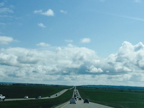 Driving from the Rocky Mountains through the Alberta plains to Calgary