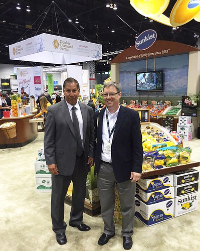 USDA Under Secretary for Marketing and Regulatory Programs Ed Avalos (left) and AMS Fruit and Vegetable Program Deputy Administrator Charles Parrott (right) walking the tradeshow floor