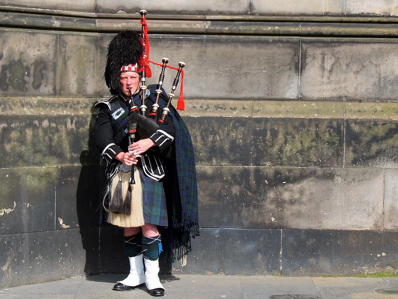 A bagpiper on the Royal Mile in Edinburgh, Scotland