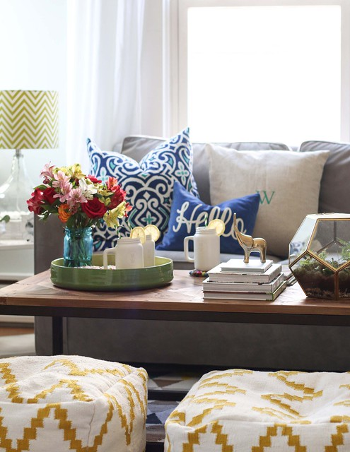 smiles and sunshine flower bouquet roses alstroemeria Peruvian lilies in blue glass mason jar vase on table with couch sofa pillows ottoman books lamp