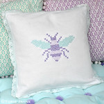 Cross stitch bee cushion and pom pom bench cushion