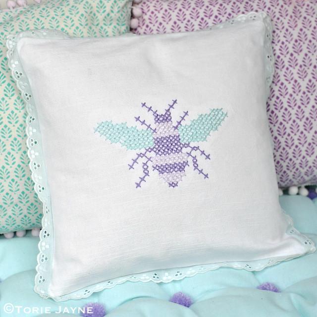 Cross stitch bee cushion and pom pom bench cushion