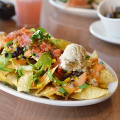 Native Nachos at the Point Loma @nativefoodscafe. Curiously, this location offers a basic version of nachos with items such as guacamole and taco meat as add ons. This basic includes: Corn tortilla chips, black beans, chipotle sauce, cashew cheese and sal