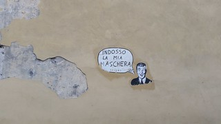 """Wearing my mask"" on a wall in Lucca"