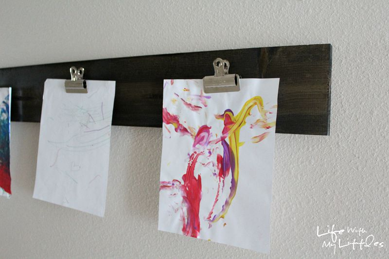 This cheap and easy way to display your child's artwork is made with a wood board and clips! It's super simple, but looks expensive!